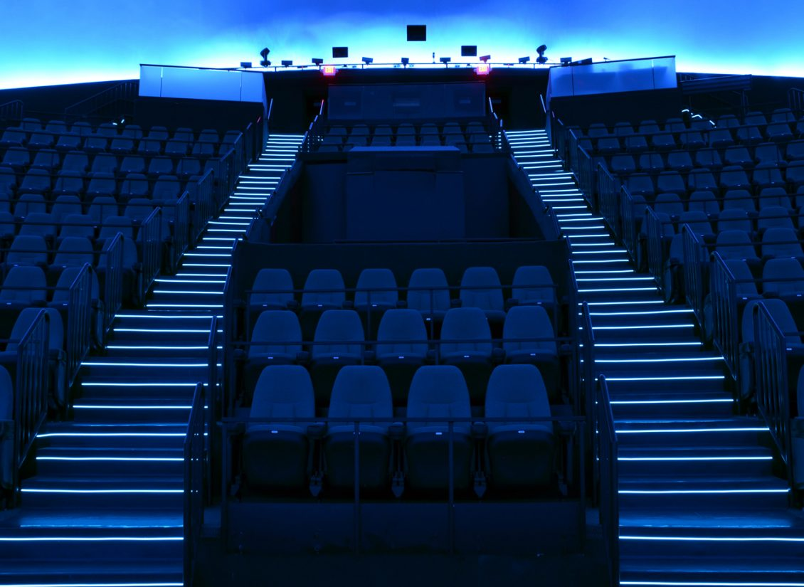 Dark blue lighted theater stairs in the Science Museum of Virginia