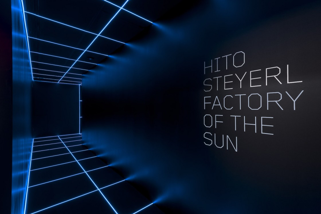 Blue Light Tape® creates a lighted grid across a room for the Factory of the Sun exhibit